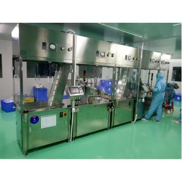 Syringe filling and closing machine